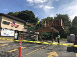 Workers doing demo on drive thru canopy
