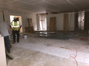Workers with framing for new office