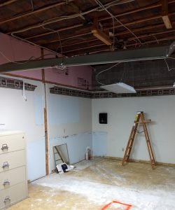 Demo of lunch room with ladder in photo
