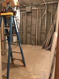 Worker on ladder inside building