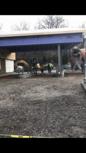 Concrete being poured in the drive-thru
