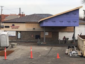 Picture of new drive-thru canopy and workers pouring concrete.