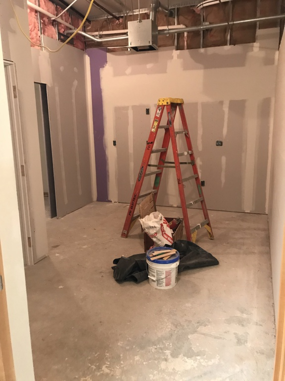 Photo of ladder and drywall materials in new employee break room