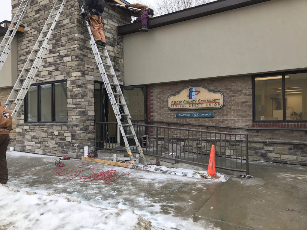 New entryway with workers on ladders