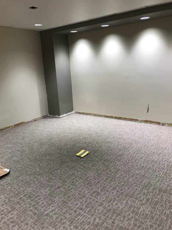 New board room with new carpeting and painted walls.